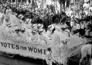 Eva McCall Hamilton and Ethelyn Haines at the helm of the Grand Rapids Equal Franchise Club float at the 1910 Grand Rapids Homecoming Parade, Bentley Historical Library.