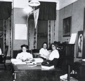State campaign Headquarters for 1912 Suffrage Campaign, Eva McCall Hamilton at center table, Grand Rapids History and Special Collections (GRHSC), Archives, GRPL, GR, Michigan.